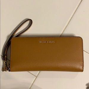 Authentic Michael Kors tan Wristlet/wallet